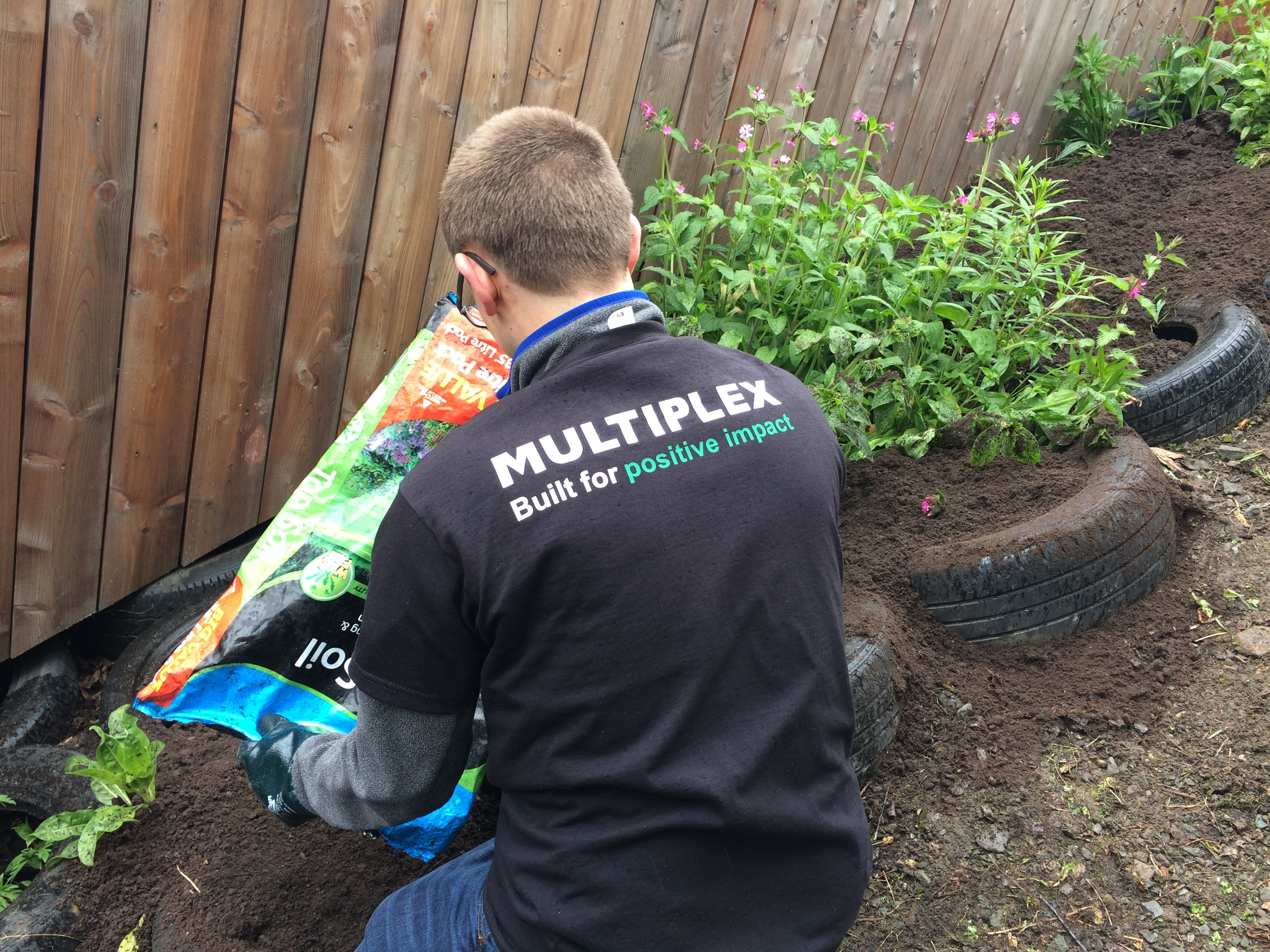 Multiplex team volunteer at Woodlands Community Garden